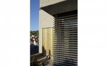 Fassadendetail Schuppen und Eckverglasung